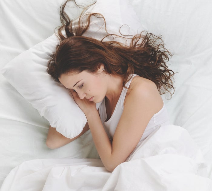 Girl Sleeping sideways on white bed - Nectar Mattress the most comfortable mattress